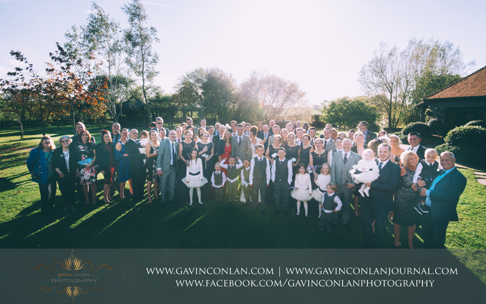 portrait of the all the guests together at Crabbs Barn. Wedding photography at  Crabbs Barn  by  gavin conlan photography Ltd