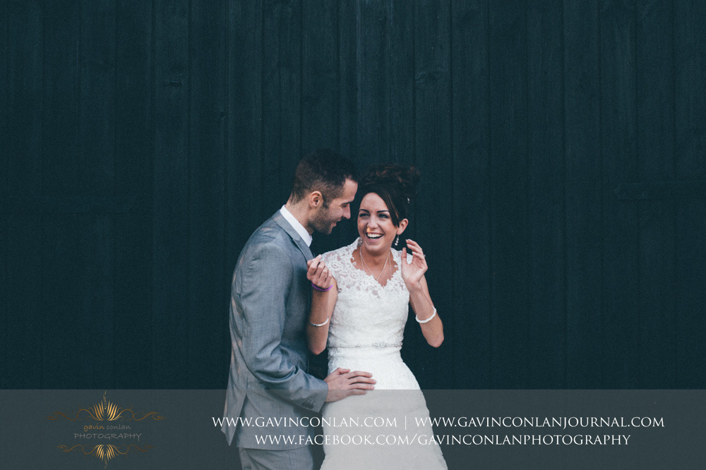 creative portrait of the bride and groom having fun together. Wedding photography at  Crabbs Barn  by  gavin conlan photography Ltd