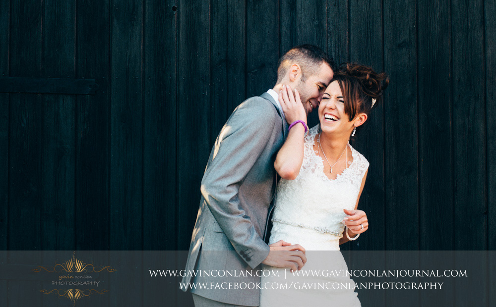 creative portrait of the bride and groom laughing together. Wedding photography at  Crabbs Barn  by  gavin conlan photography Ltd