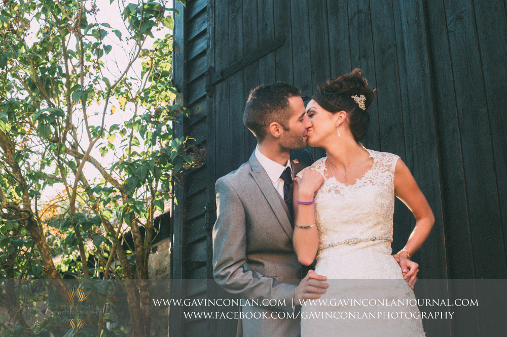 creative portrait of the bride and groom kissing. Wedding photography at  Crabbs Barn  by  gavin conlan photography Ltd