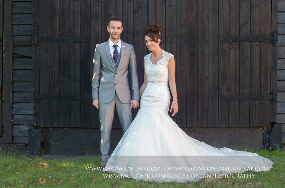 full length portrait of the bride and groom holding hands. Wedding photography at  Crabbs Barn  by  gavin conlan photography Ltd