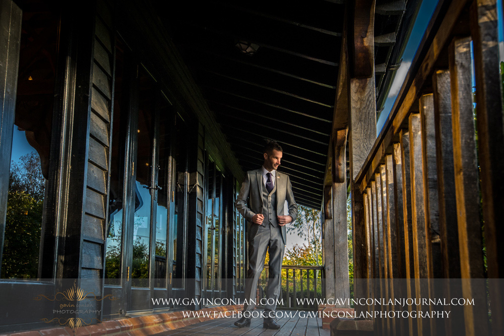 creative full length groom portrait. Wedding photography at  Crabbs Barn  by  gavin conlan photography Ltd