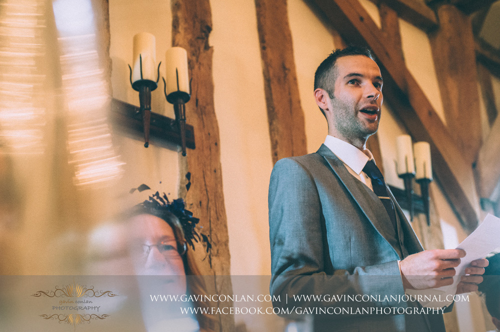 creative portrait of the groom during his speech. Wedding photography at  Crabbs Barn  by  gavin conlan photography Ltd