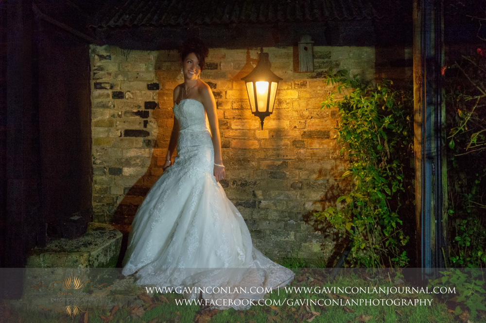 creative night time bridal portrait. Wedding photography at  Crabbs Barn  by  gavin conlan photography Ltd