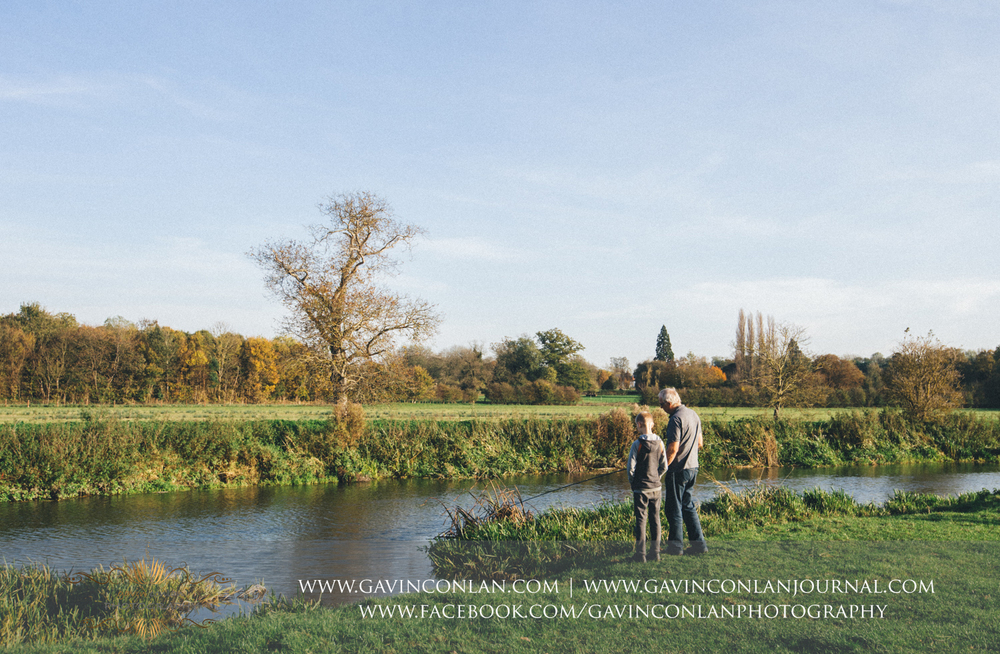 father and son fishing in the River Cam at Grantchester Meadows, Cambridgeshire