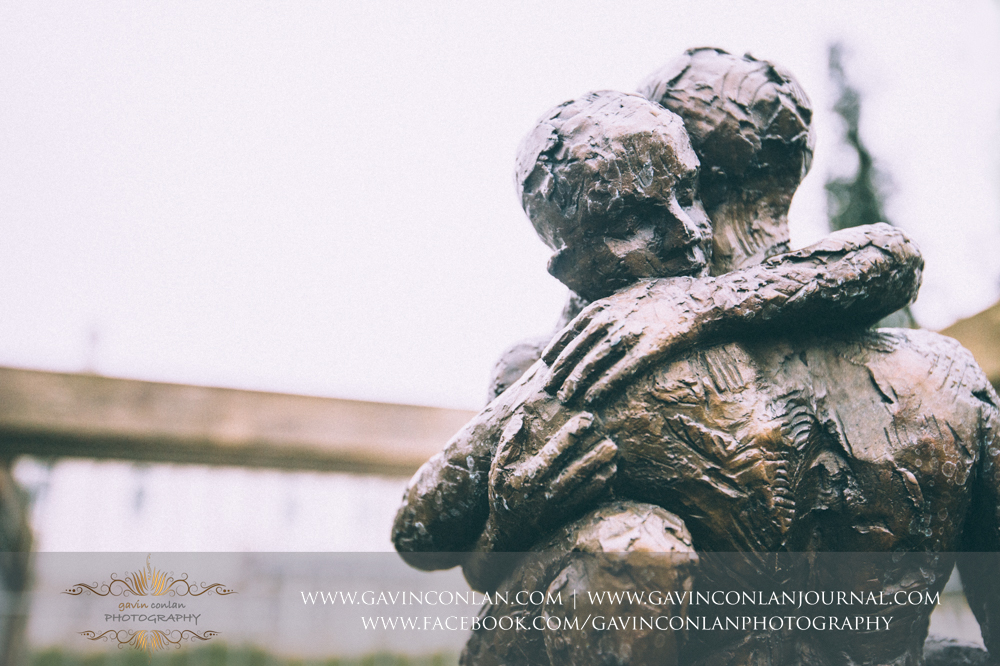 a beautiful statue of two people hugging in the grounds of  Coworth Park Hotel  by  gavin conlan photography Ltd