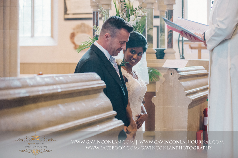 the beautiful bride looking at her new husband with so much joy, happiness and love, wedding photography at  All Saints Church Marlow  by  gavin conlan photography Ltd