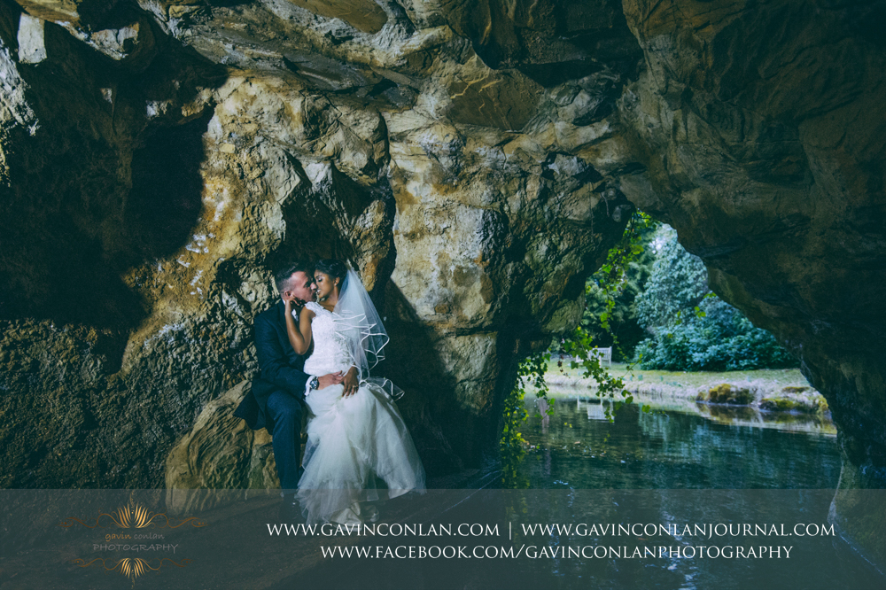 signature style bride and groom portrait in the amazing cave, wedding photography at  Heatherden Hall Pinewood Studios  by  gavin conlan photography Ltd