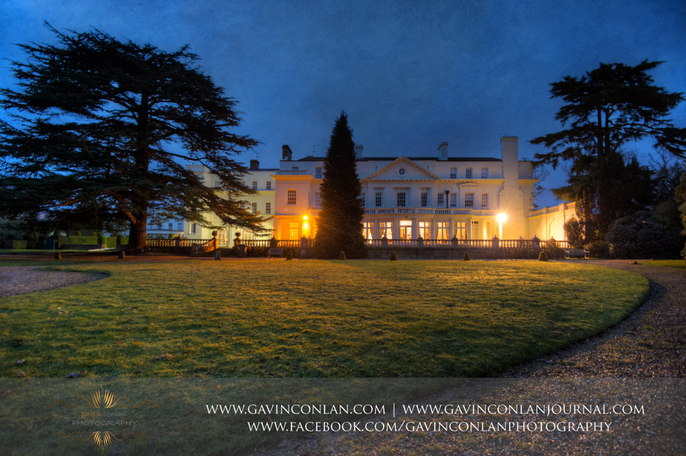fine art exterior of Heatherden Hall at dusk, wedding photography at  Heatherden Hall Pinewood Studios  by  gavin conlan photography Ltd