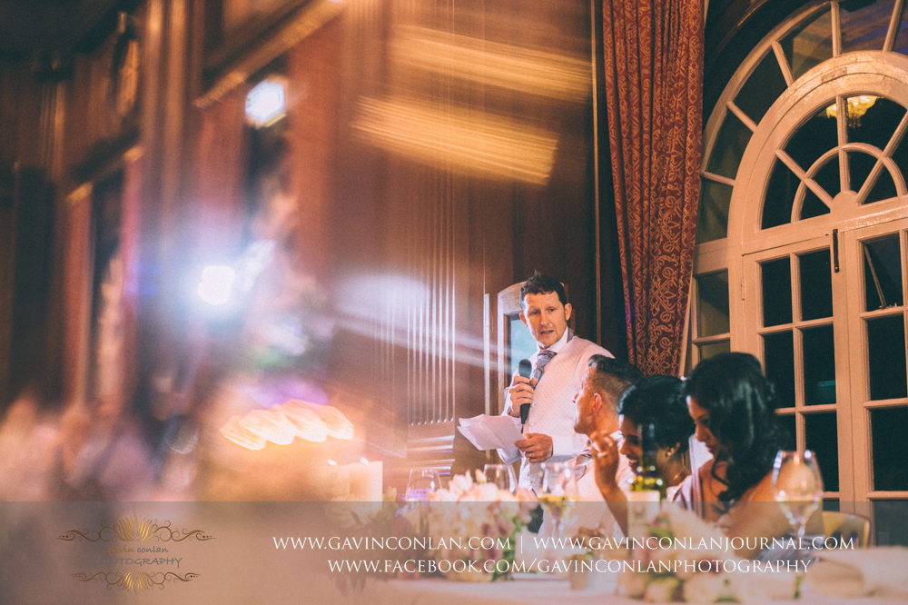creative portrait of the best man during his speech, wedding photography at  Heatherden Hall Pinewood Studios  by  gavin conlan photography Ltd