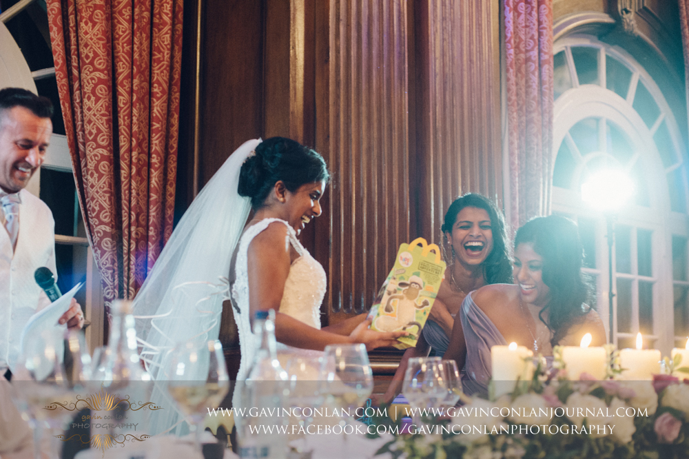 the bride sharing a joke with her beautiful brides maids, wedding photography at  Heatherden Hall Pinewood Studios  by  gavin conlan photography Ltd