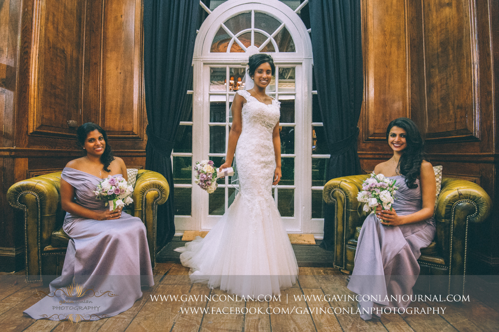 signature style portrait of the bride and her bridesmaids looking stunning, wedding photography at  Heatherden Hall Pinewood Studios  by  gavin conlan photography Ltd