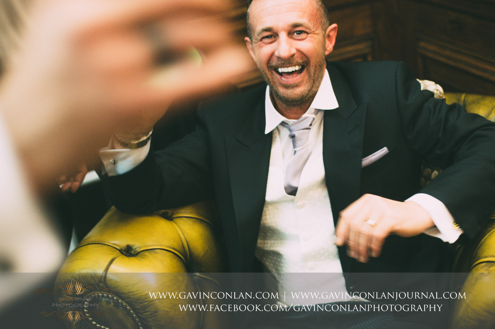 beautiful nature portrait of the groom laughing, wedding photography at  Heatherden Hall Pinewood Studios  by  gavin conlan photography Ltd