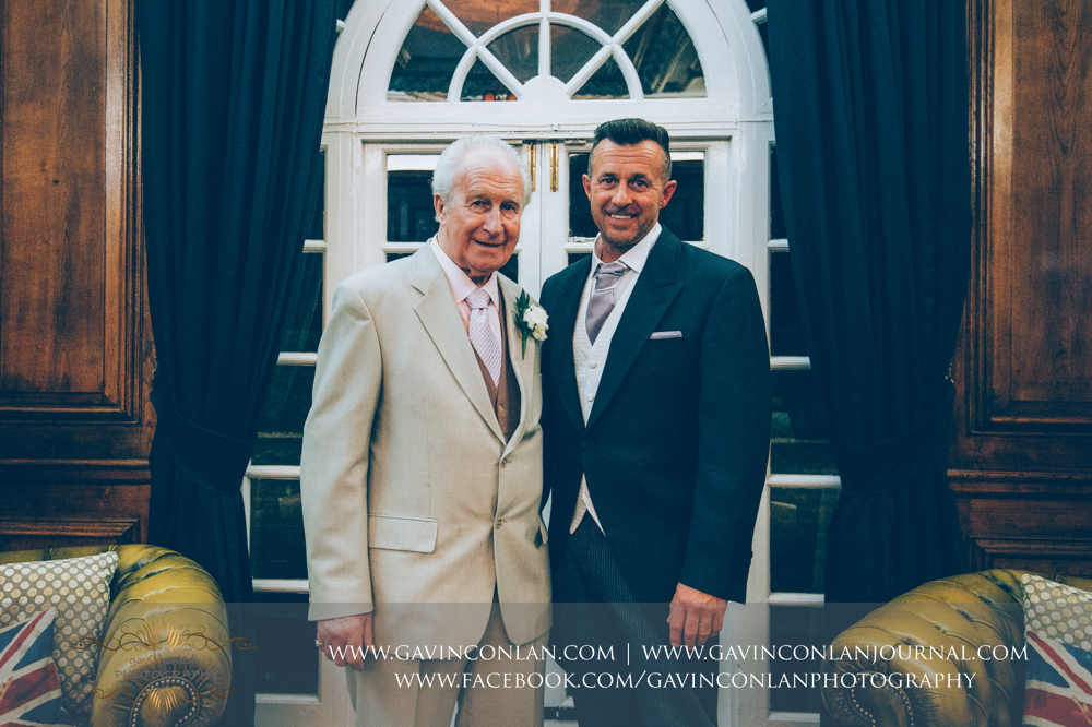 portrait of the groom and his father, wedding photography at  Heatherden Hall Pinewood Studios  by  gavin conlan photography Ltd