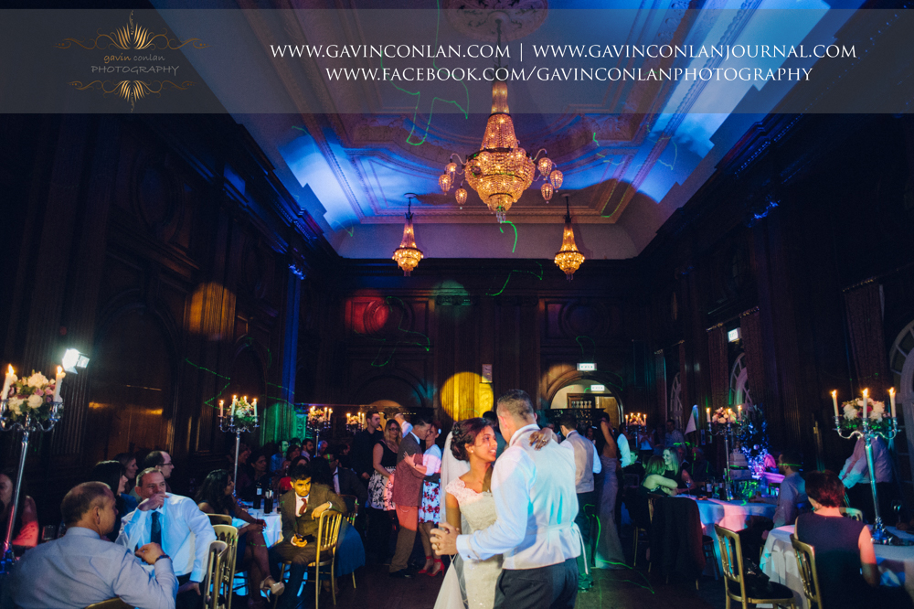 the bride and groom having their first dance in the stunning ballroom, wedding photography at  Heatherden Hall Pinewood Studios  by  gavin conlan photography Ltd