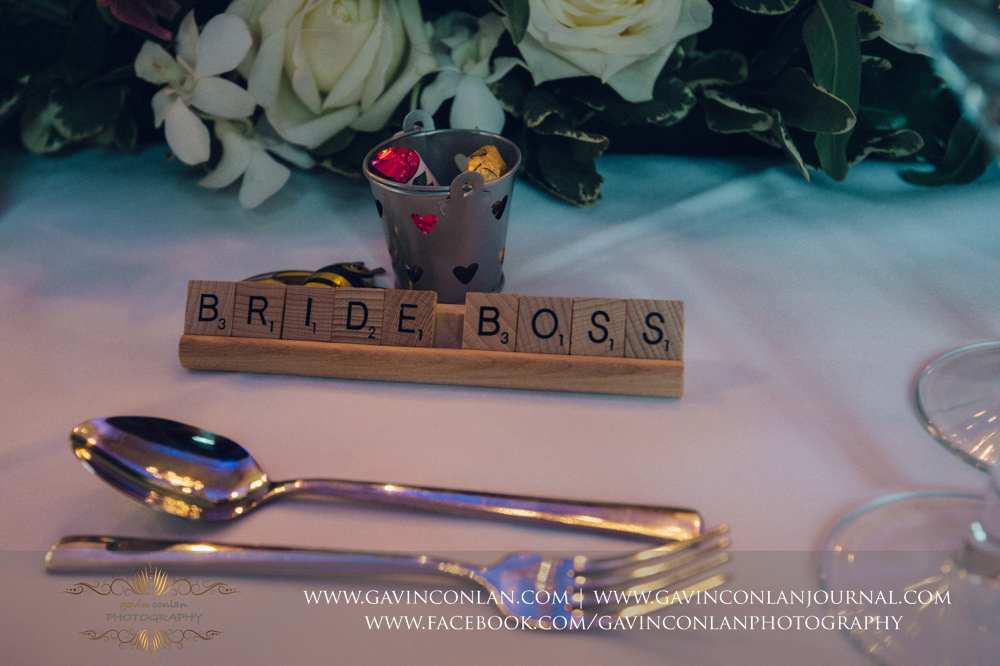 the brides name plate made out of wooden scrabble pieces, wedding photography at  Heatherden Hall Pinewood Studios  by  gavin conlan photography Ltd
