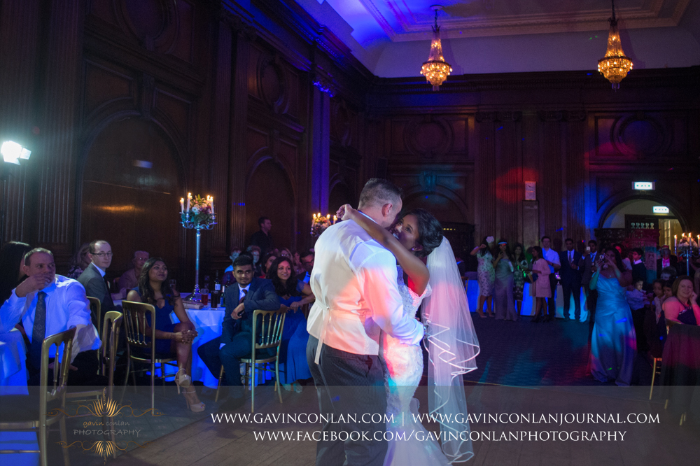the bride and groom having their first dance with their guests looking on with pure joy, wedding photography at  Heatherden Hall Pinewood Studios  by  gavin conlan photography Ltd