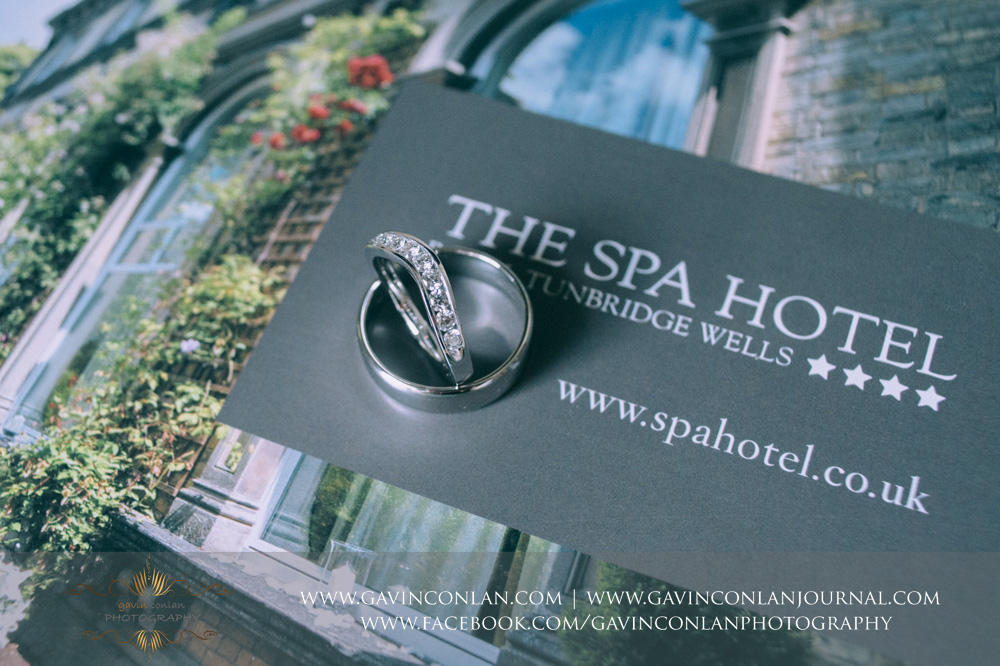 creative detail shot of their wedding rings displayed on the SPA Hotel magazine . Wedding photography at  The SPA Hotel  by  gavin conlan photography Ltd
