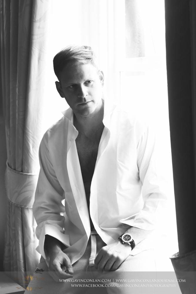 black and white portrait of the groom posing as his getting dressed. Wedding photography at  The SPA Hotel  by  gavin conlan photography Ltd