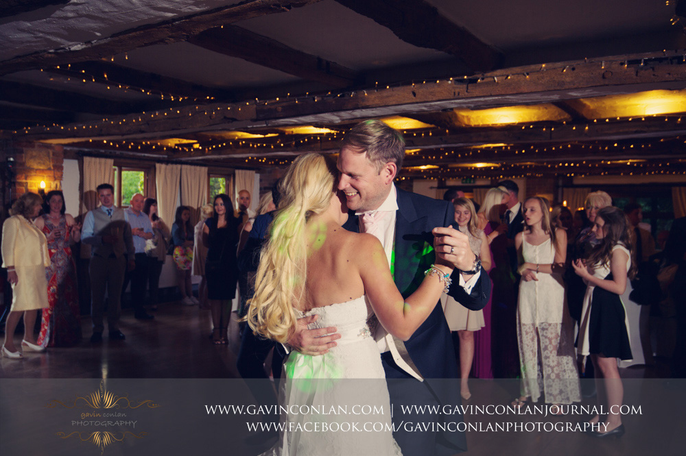 the bride and groom during their first dance showing the groom looking so happy. Wedding photography at  High Rocks  by preferred supplier  gavin conlan photography Ltd
