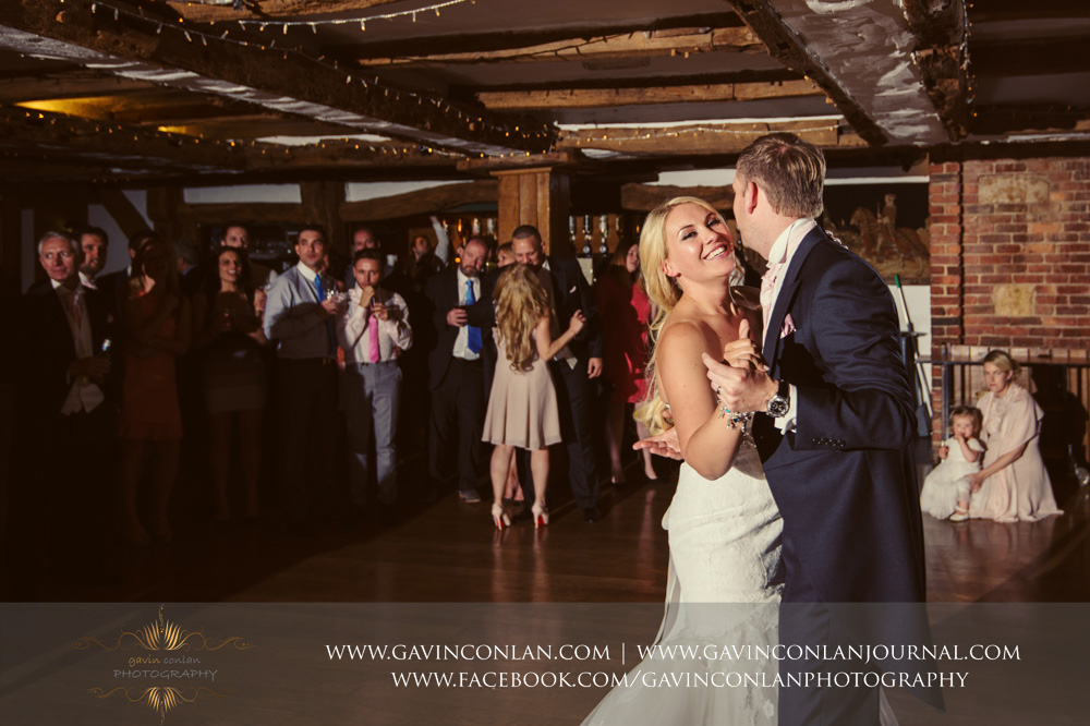 the bride and groom during their first dance showing the bride looking so happy. Wedding photography at  High Rocks  by preferred supplier  gavin conlan photography Ltd