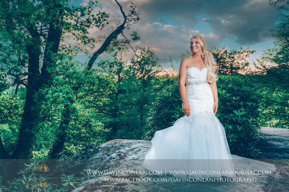 creative bridal portrait taken at the top of The Rocks at dusk. Wedding photography at  High Rocks  by preferred supplier  gavin conlan photography Ltd