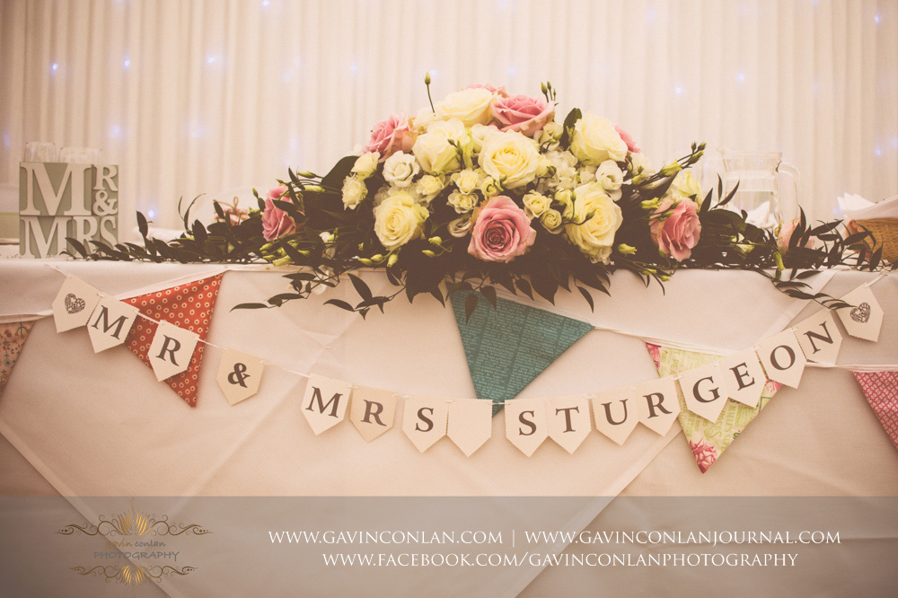 vintage detail shot of Mr and Mrs Sturgeon table sign. Wedding photography at  Parklands Quendon Hall  by preferred supplier  gavin conlan photography Ltd