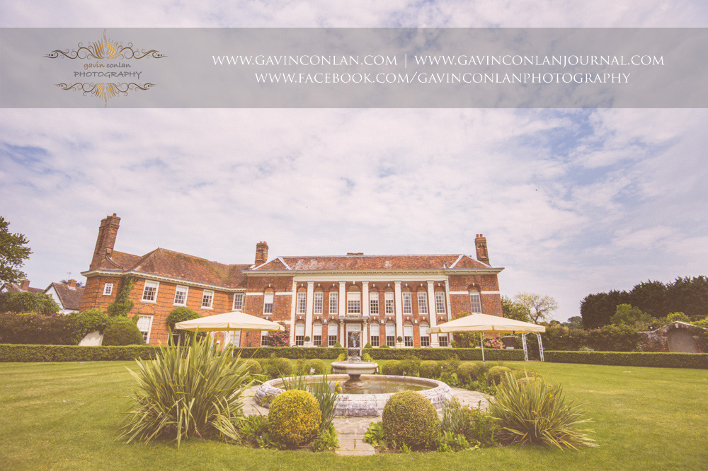exterior of Parklands Quendon Hall showcasing the beautiful fountain. Fine art wedding photography at  Parklands Quendon Hall  by preferred supplier  gavin conlan photography Ltd