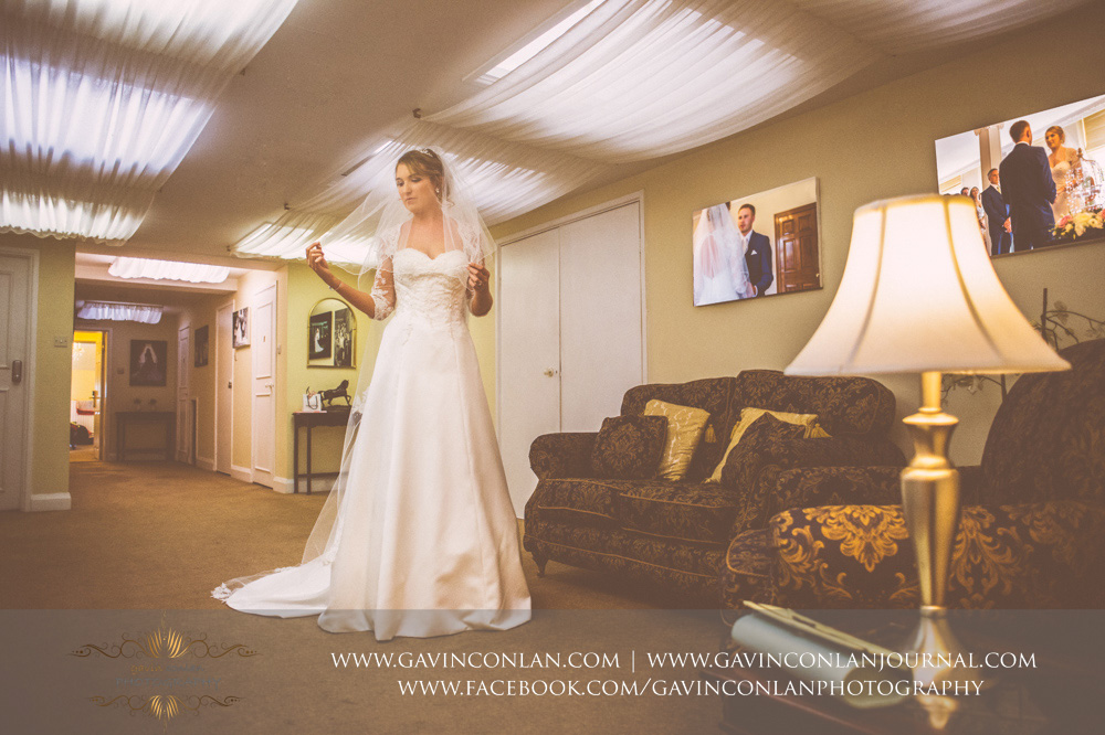 creative bridal portrait of the bride posing in the bridal suite. Wedding photography at  Parklands Quendon Hall  by preferred supplier  gavin conlan photography Ltd