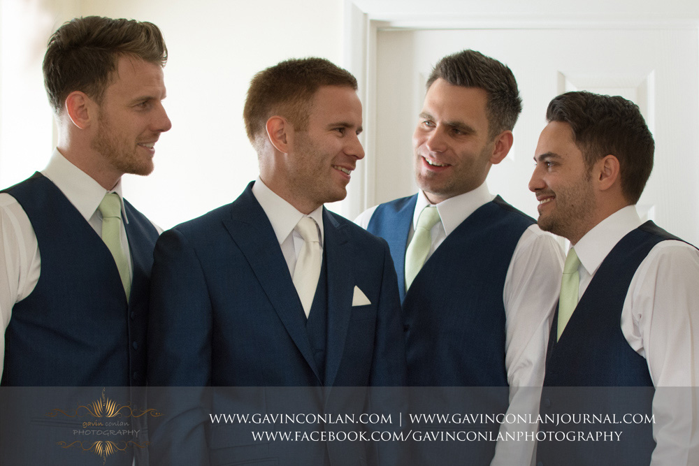 creative portrait of the groom and his 3 best men after they finished getting ready. Wedding photography at  Parklands Quendon Hall  by preferred supplier  gavin conlan photography Ltd