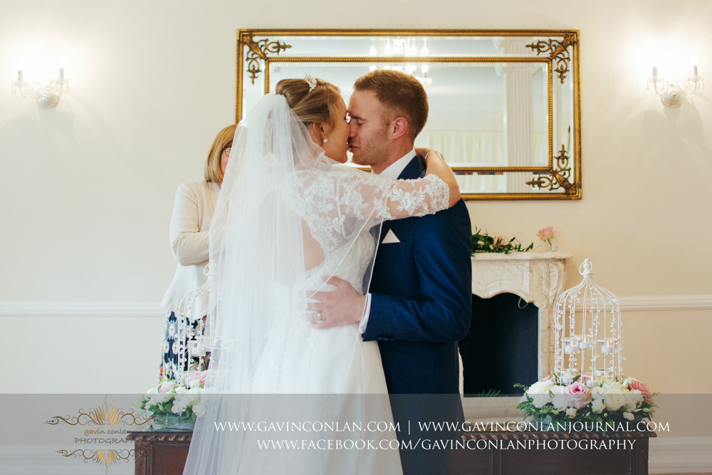 their first kiss as Mr and Mrs Sturgeon - a beautiful moment during their wedding ceremony. Wedding photography at Parklands Quendon Hall by preferred supplier gavin conlan photography Ltd