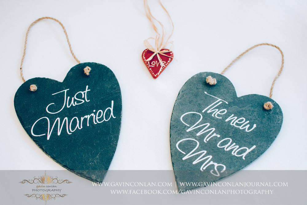 creative detail photo of two signs, one saying Just Married and the other The New Mr and Mrs. Wedding photography at Parklands Quendon Hall by preferred supplier gavin conlan photography Ltd