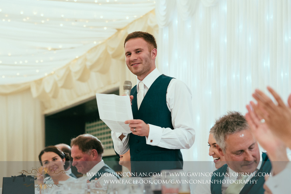 creative portrait of the groom during his speech. Wedding photography at  Parklands Quendon Hall  by preferred supplier  gavin conlan photography Ltd