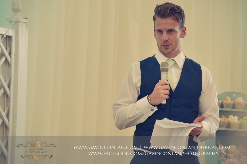creative portrait of one of the best men during his speech. Wedding photography at  Parklands Quendon Hall  by preferred supplier  gavin conlan photography Ltd