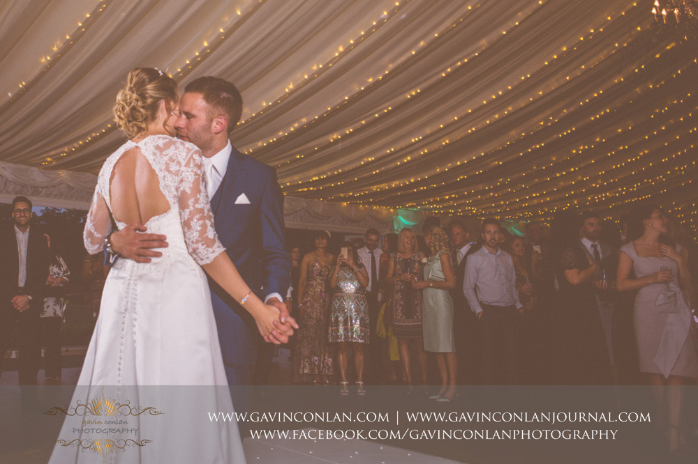 creative portrait of the bride and groom during their first dance song - All of Me by John Legend. Wedding photography at  Parklands Quendon Hall  by preferred supplier  gavin conlan photography Ltd