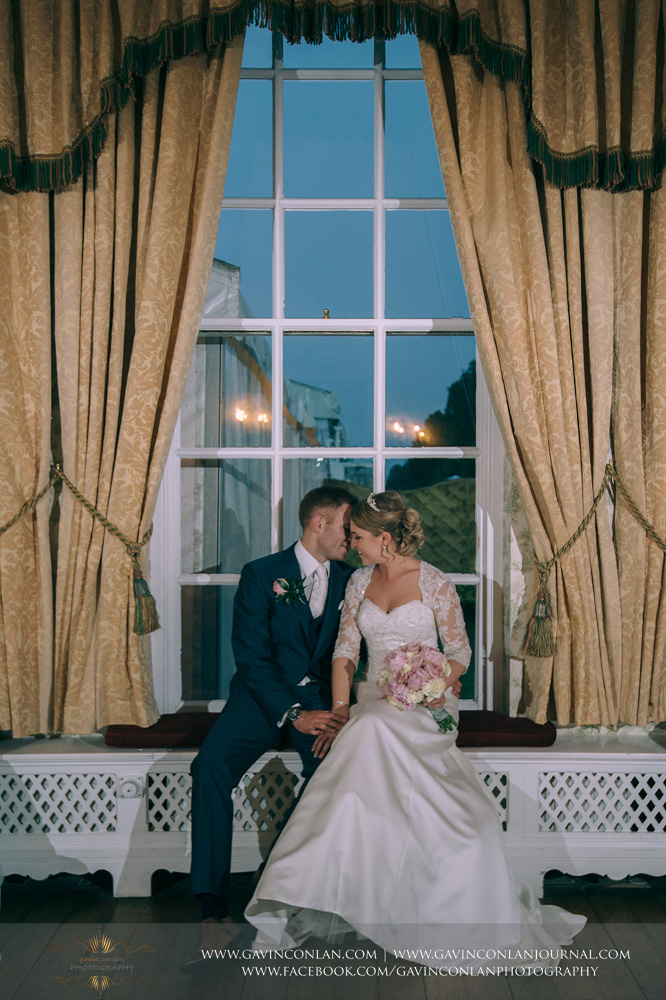creative portrait of the bride and groom in the drawing room. Wedding photography at Parklands Quendon Hall by preferred supplier gavin conlan photography Ltd