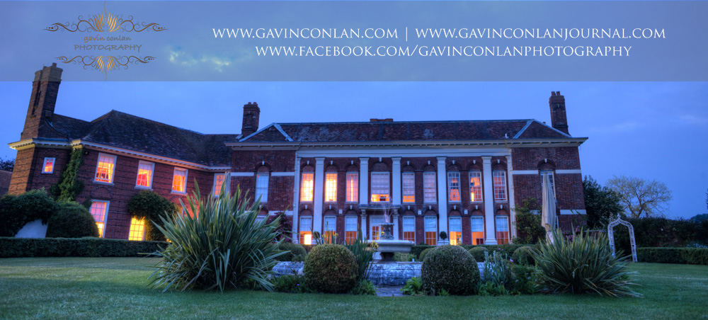 night time exterior of Parklands Quendon Hall showcasing the beautiful fountain. Fine art wedding photography at  Parklands Quendon Hall  by preferred supplier   gavin conlan photography Ltd