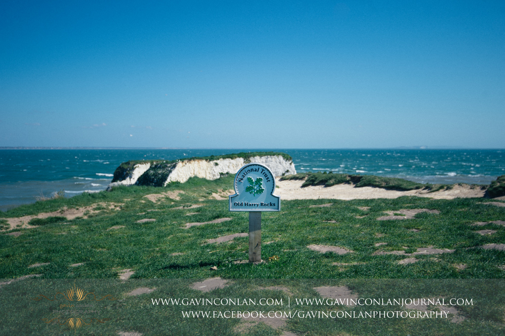 fine art landscape showing the National Trust  Old Harry Rocks  sign. Victoria and James Engagement Session in Bournemouth, Dorset by  gavin conlan photography Ltd
