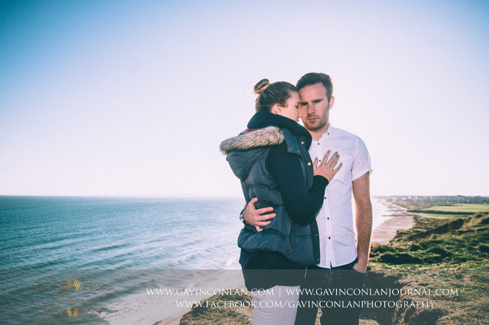 fashion portrait of Victoria and James at  Hengistbury Head .  Engagement Session in Bournemouth, Dorset by  gavin conlan photography Ltd