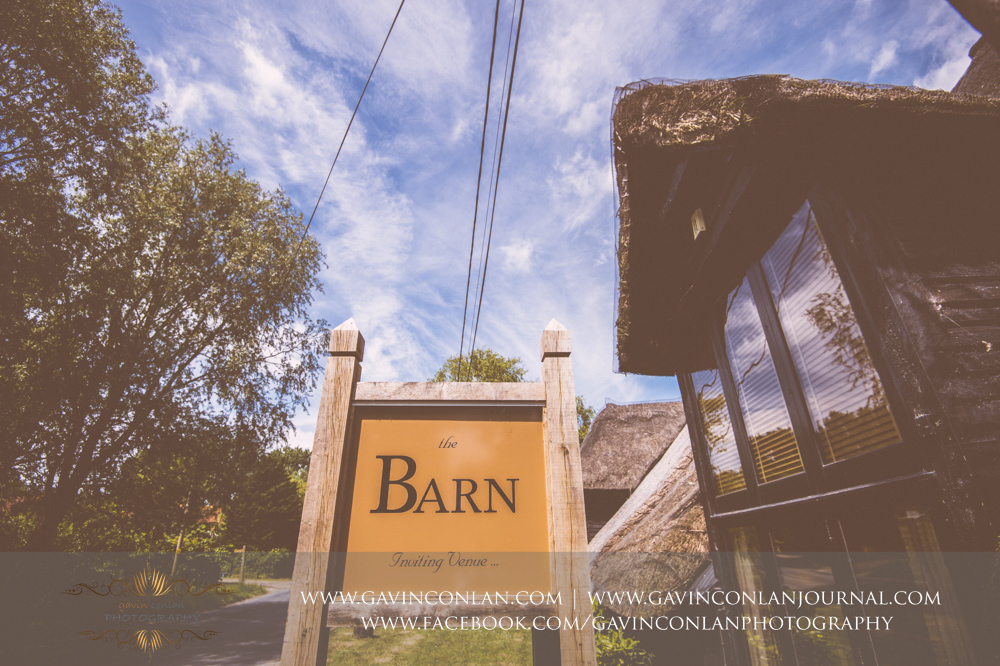 creative exterior photograph of The Barn showcasing the new signage. Wedding photography at The Barn Brasserie by Essex wedding photographer gavin conlan photography Ltd