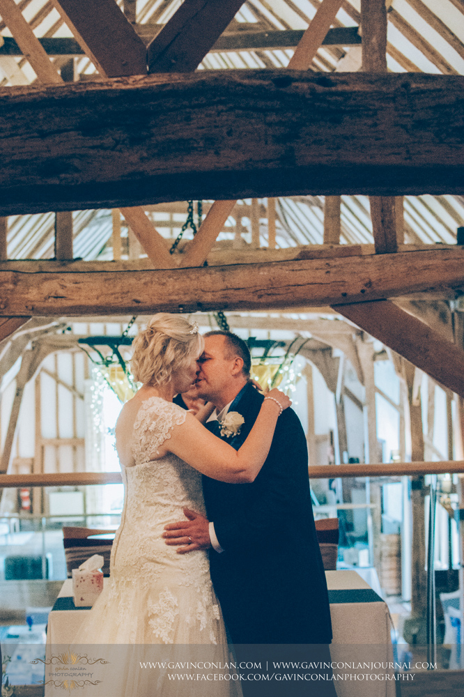 a portrait of the bride and groom sharing their first kiss as Mr and Mrs. Wedding photography at The Barn Brasserie by Essex wedding photographer gavin conlan photography Ltd