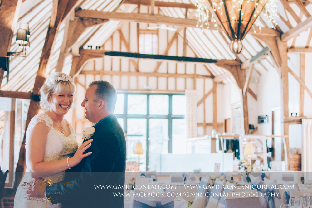 creative portrait of the bride and groom sharing a beautiful moment inside The Barn. Wedding photography at  The Barn Brasserie  by Essex wedding photographer  gavin conlan photography Ltd
