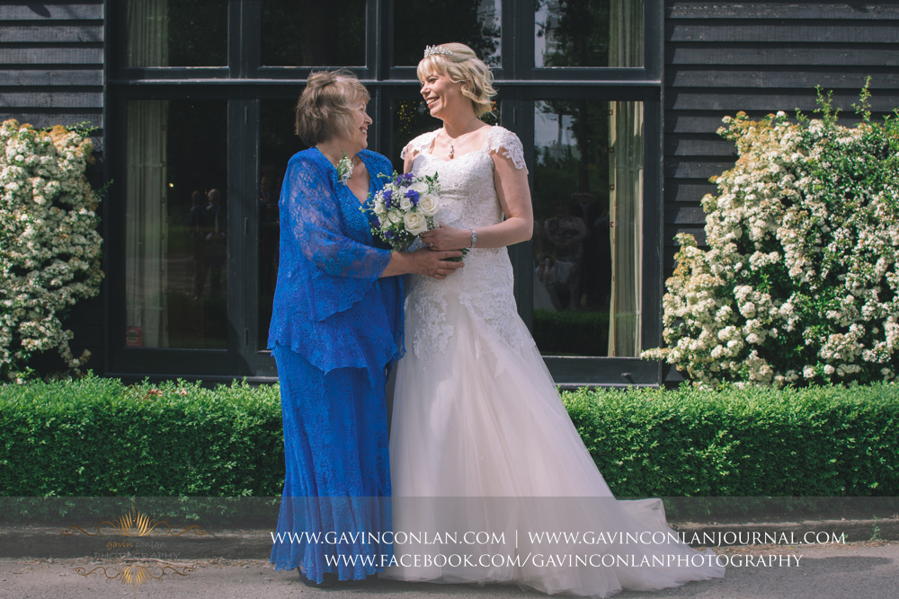 beautiful portrait of the bride with her mother outside The Barn. Wedding photography at The Barn Brasserie by Essex wedding photographer gavin conlan photography Ltd