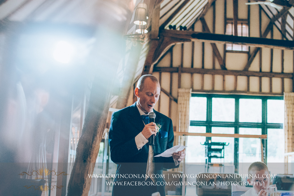brother of the bride during his speech. Wedding photography at The Barn Brasserie by Essex wedding photographer gavin conlan photography Ltd