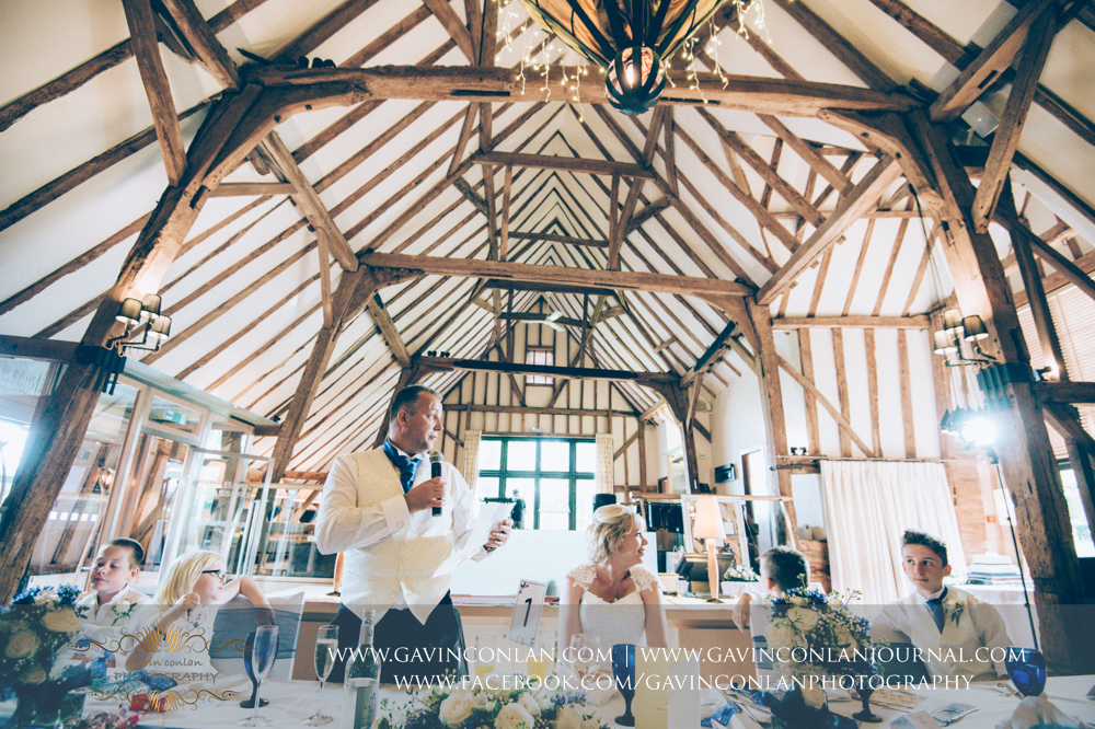 the groom during his speech. Wedding photography at The Barn Brasserie by Essex wedding photographer gavin conlan photography Ltd