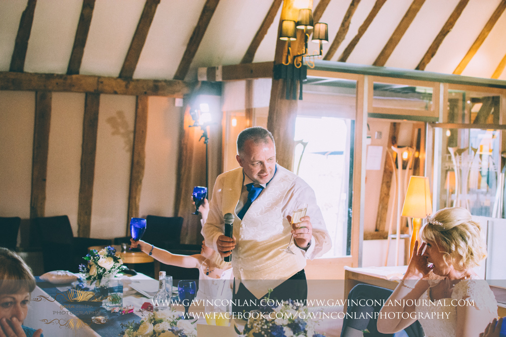 the groom toasting his beautiful wife during his speech. Wedding photography at The Barn Brasserie by Essex wedding photographer gavin conlan photography Ltd
