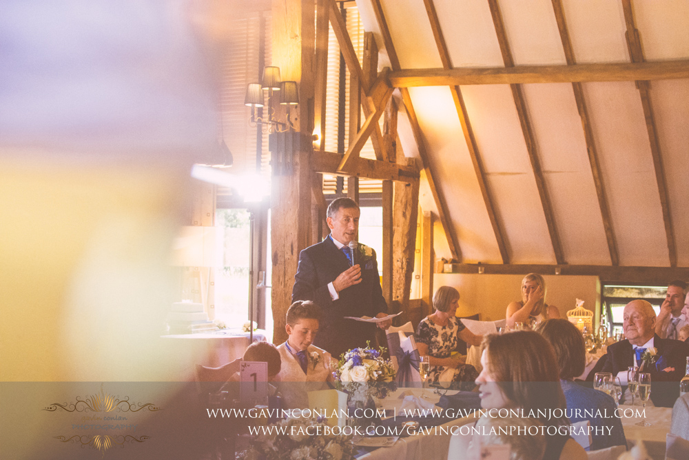 creative portrait of the father of the groom during his speech. Wedding photography at The Barn Brasserie by Essex wedding photographer gavin conlan photography Ltd