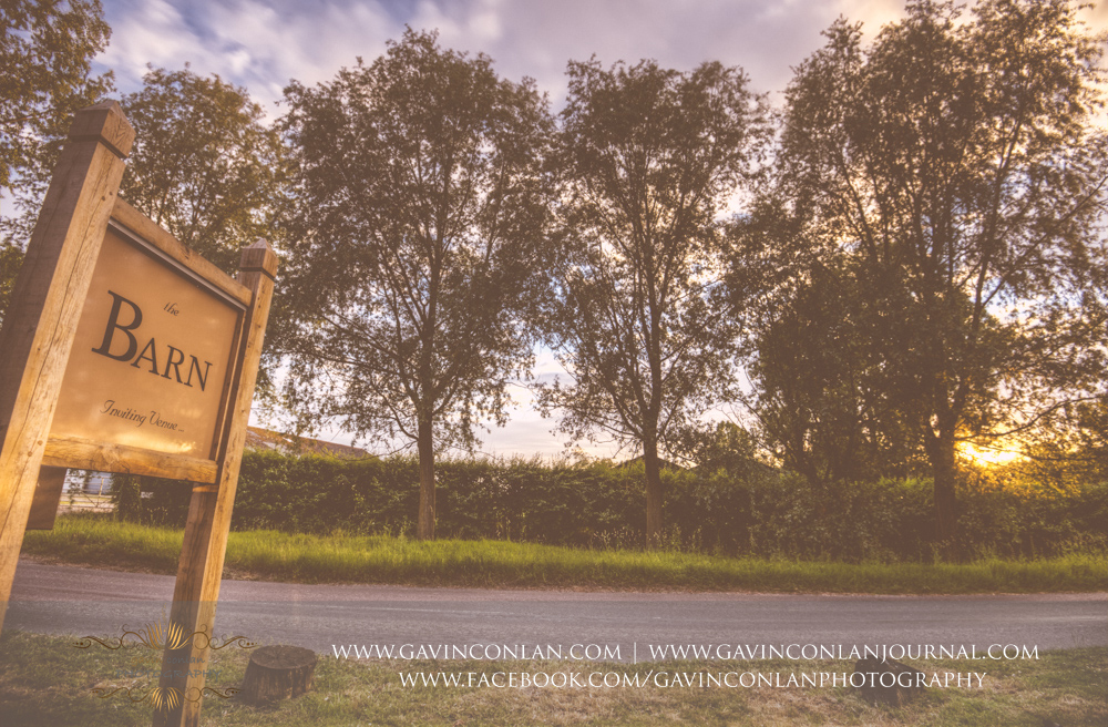 creative landscape showing The Barn signage and sunset. Wedding photography at The Barn Brasserie by Essex wedding photographer gavin conlan photography Ltd