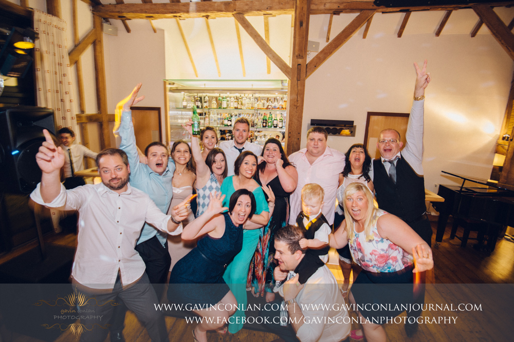 fun portrait of their guests on the dance floor. Wedding photography at  The Barn Brasserie  by Essex wedding photographer  gavin conlan photography Ltd