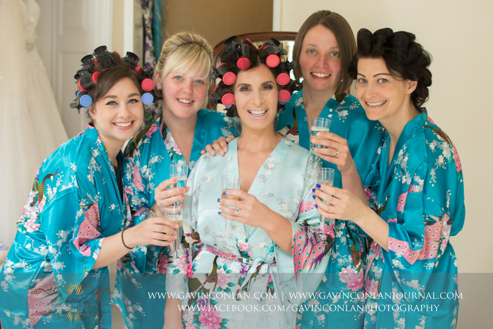 fun portrait of the bride and her bridesmaids wearing their kimonos. Wedding photography at  Gosfield Hall  by Essex wedding photographer  gavin conlan photography Ltd